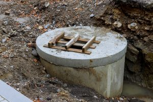 Water distribution well replacing reconstruction of city utility sewage system steel pipes